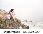 lonely kid girl sitting at... | Shutterstock . vector #1333605620