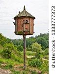 A Wooden Birdhouse In A Spring...