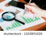 businessman shows statistics... | Shutterstock . vector #1333851020