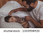 loving father tucking blanket...   Shutterstock . vector #1333908920