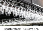 Glasses Hanging Over A Bar Rack
