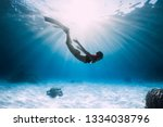 Young Woman Free Diver Glides...