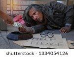 homeless man is lie down on...   Shutterstock . vector #1334054126