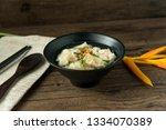 shrimp wonton in hot soup in... | Shutterstock . vector #1334070389