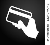 hand holding a credit card icon. | Shutterstock .eps vector #1334079743