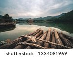 mirror lake with bamboo hut... | Shutterstock . vector #1334081969