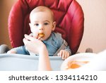 baby boy 1 year old eating... | Shutterstock . vector #1334114210