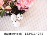 easter eggs with funny faces ... | Shutterstock . vector #1334114246