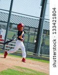 Youth Baseball Boy Swinging Th...