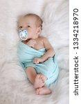 sleeping newborn baby wrapped... | Shutterstock . vector #1334218970
