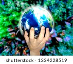 hand holding touch earth  ... | Shutterstock . vector #1334228519
