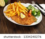 Breaded Schnitzel With French...