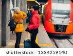 young female and railway train. | Shutterstock . vector #1334259140