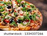 pizza with mozzarella cheese ... | Shutterstock . vector #1334337266
