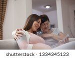 mother and daughter sitting on... | Shutterstock . vector #1334345123
