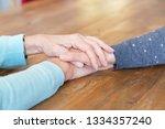 closeup of senior woman holding ... | Shutterstock . vector #1334357240