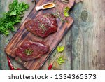 marinating meat with spices and ... | Shutterstock . vector #1334365373
