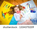 young happy girl drawing and...   Shutterstock . vector #1334370209