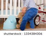 a small toddler boy  peeing in... | Shutterstock . vector #1334384306