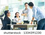 group of four happy young asian ... | Shutterstock . vector #1334391230