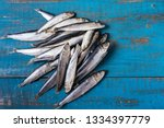 Stock photo rustic style fish pattern herring fish on an old blue wooden background flat lay copy space 1334397779