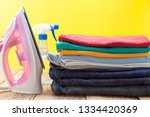 iron and stack of colored... | Shutterstock . vector #1334420369