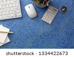 business objects on blue table... | Shutterstock . vector #1334422673