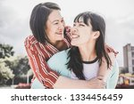 asian mother and daughter... | Shutterstock . vector #1334456459