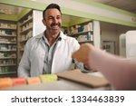 customer handing a medical... | Shutterstock . vector #1334463839