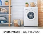 interior of a real laundry room ... | Shutterstock . vector #1334469920
