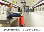 attractive girl traveler... | Shutterstock . vector #1334475410