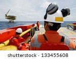 workers on transport boat to... | Shutterstock . vector #133455608