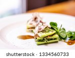Stock photo vegan raw zucchini lasagna with pesto and tomato sauce served on a plate 1334560733