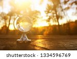 small crystal globe in front of ... | Shutterstock . vector #1334596769
