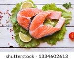 raw salmon fish steak with... | Shutterstock . vector #1334602613