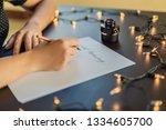 Calligrapher Hands Writes...