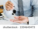 agent giving a car vehicle key... | Shutterstock . vector #1334643473
