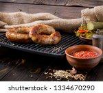 spicy homemade sausages pork... | Shutterstock . vector #1334670290