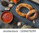 spicy homemade sausages pork... | Shutterstock . vector #1334670299