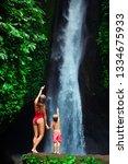 in tropical jungle happy mother ... | Shutterstock . vector #1334675933