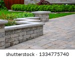 A Seat Wall With Pillars And...