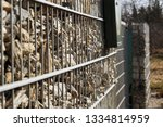 gabions. a fence around the... | Shutterstock . vector #1334814959