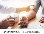 doctor using stethoscope take a ... | Shutterstock . vector #1334868083