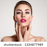 beautiful fashion woman with a... | Shutterstock . vector #1334877989