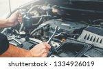 Auto Mechanic Working In Garage ...