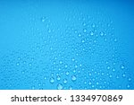 water drops on blue background | Shutterstock . vector #1334970869