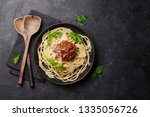 spaghetti bolognese pasta with... | Shutterstock . vector #1335056726