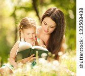 mother with daughter read a... | Shutterstock . vector #133508438