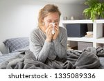 frustrated girl catching cold ...   Shutterstock . vector #1335089336