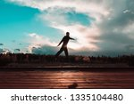 young man jump on roof in... | Shutterstock . vector #1335104480